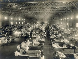 people shown in hospital beds