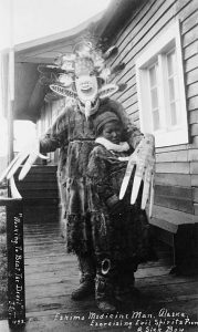 "Yup'ik ""medicine man exorcising evil spirits from a sick boy"" in Nushagak, Alaska, 1890s."