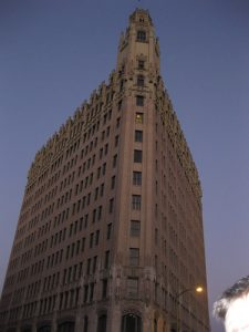 View of the Emily Morgan Hotel in the evening, showing its flatiron facade.
